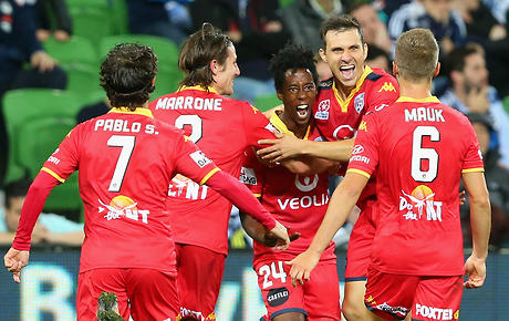MELBOURNE, AUSTRALIA - FEBRUARY 19: Bruce Kamau of United is congratulated by team mates after scoring a goal during the round 20 A-League match between Melbourne Victory and Adelaide United at AAMI Park on February 19, 2016 in Melbourne, Australia. (Photo by Quinn Rooney/Getty Images)