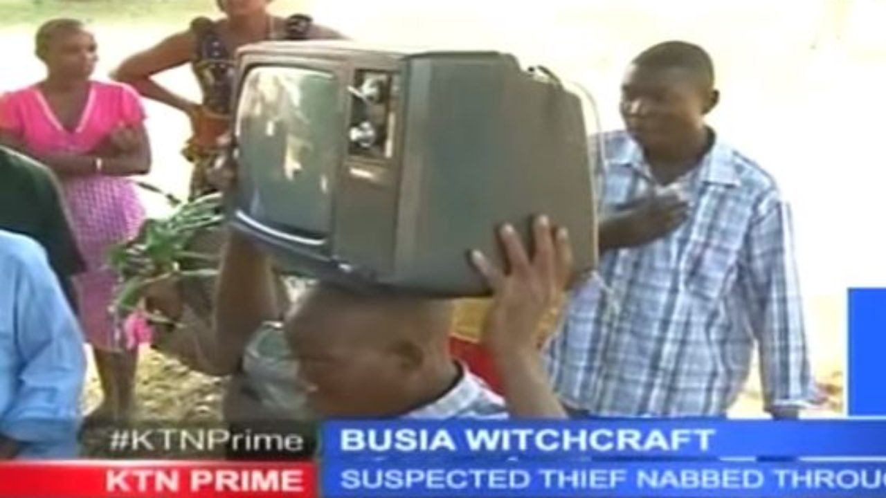 VIDEO - Drama in Busia as Thief Returns with Stolen TV Stuck on His Head