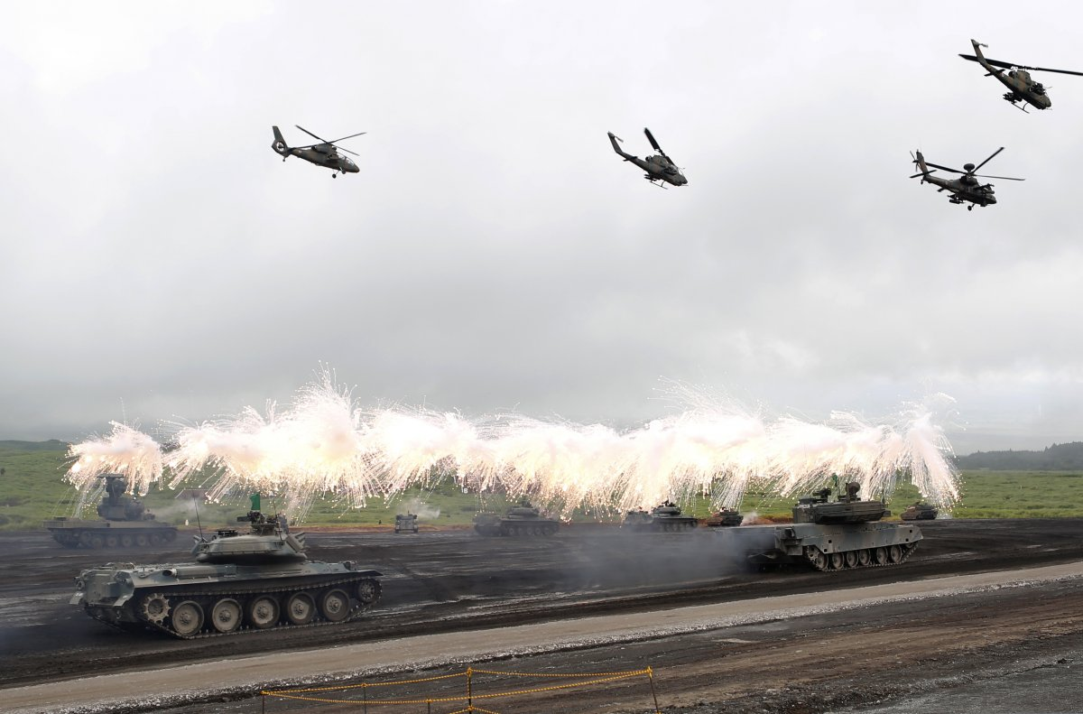 Japanese tanks and helicopters participate in a military-training exercise.(Yuya Shino/REUTERS)