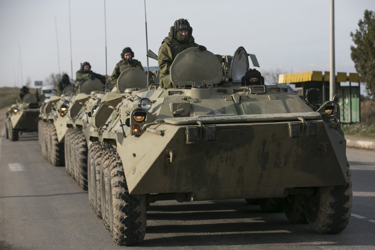 Russian soldiers on military armored-personnel carriers on a road near the Crimean port city of Sevastopol on March 10, 2014.(REUTERS/Baz Ratner)