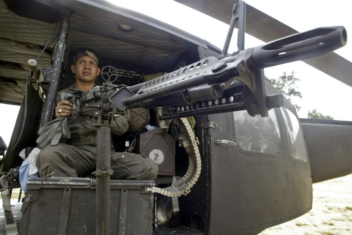 A Thai solider keeps guard from a military helicopter after arriving in southern Thailand's Narathiwat Province on March 2, 2007. (Surapan Boonthanom/REUTERS)